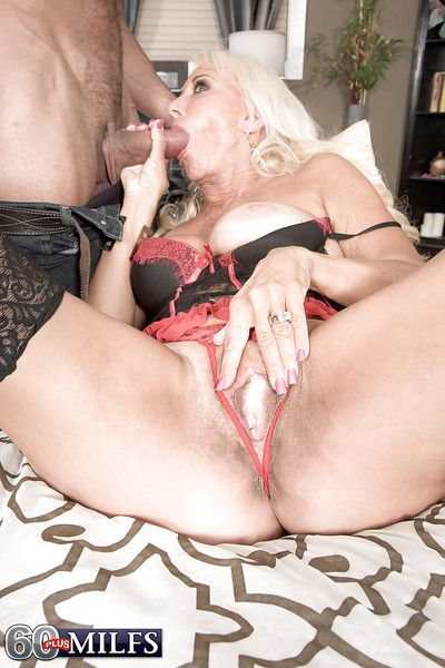 Blonde granny Madison Milstar giving black cock bj in lingerie