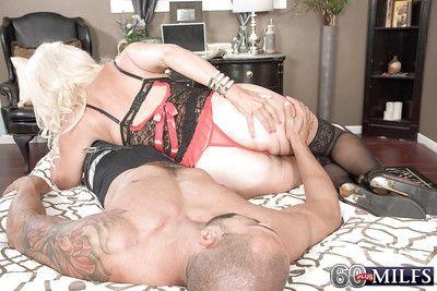 Blonde granny Madison Milstar giving black cock bj in lingerie