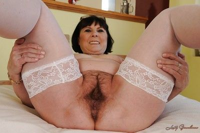 Chubby granny in white stockings stripping and exposing her hairy twat