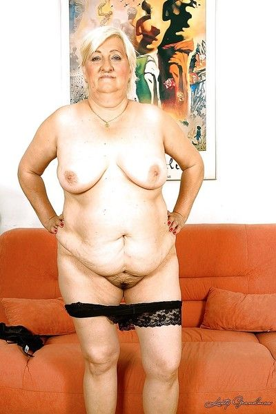 Fatty granny masturbating her hairy slit with a huge dildo