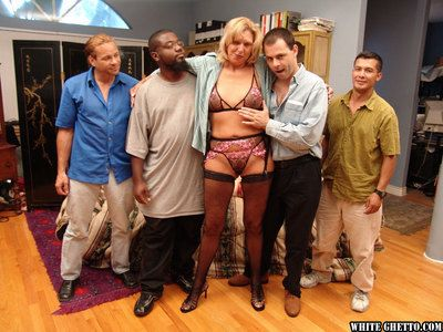 Jizz starving granny in stockings has some fun with three horny guys