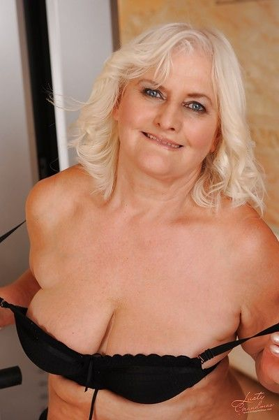 Chubby granny with massive jugs stripping off her lingerie
