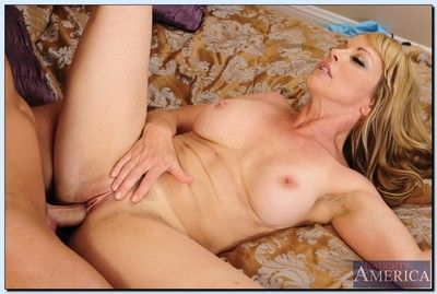 Shayla LaVeaux fucks a younger stud and gets jizzed over her belly and jugs