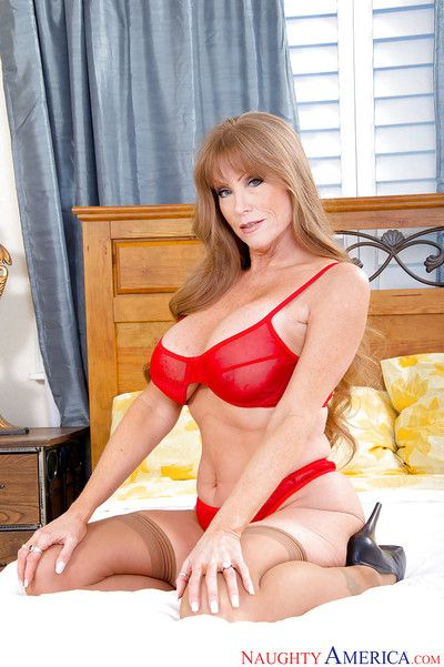 Experienced woman Darla Crane striking hot poses in pantyhose and underwear
