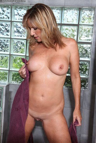 Busty mature lady Jodi West masturbating her wet pussy in shower