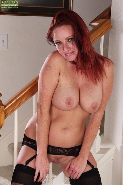 Sweet redhead Brandie Jones is showing her perfect legs in high heels