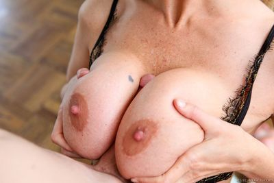 This busty milf Julia Ann knows how to suck a cock to make it produce loads of semen