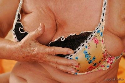 Lecherous granny takes off her lingerie and vibes her hairy slit