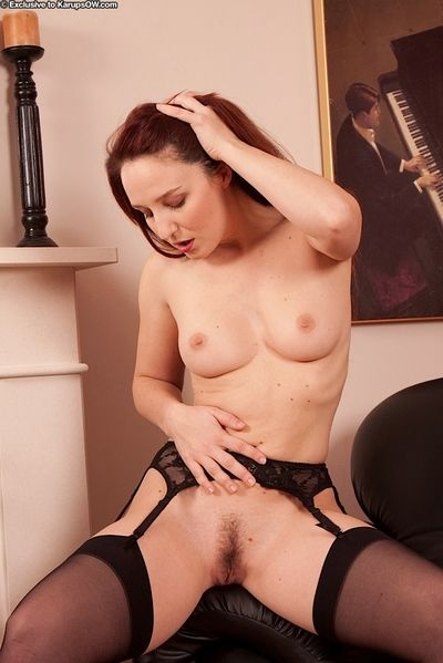 Stocking clad older woman Charlotte freeing hairy pussy from underwear