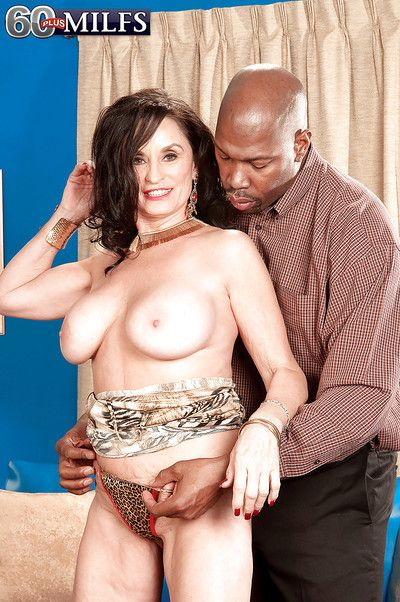 Rita Daniels took off her tight dress and shows off her big boobs to her horny black lover.