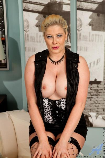 Blonde milf Michelle Barrett in nice fishnet stockings shows the real treasure of big melons