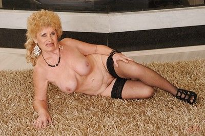 Lecherous granny in nylon stockings taking off her clothes