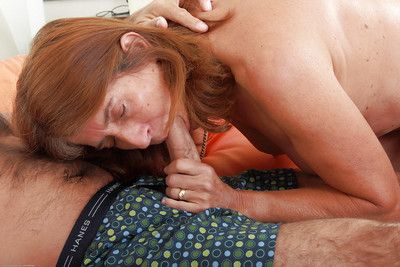 Horny amateur granny Meg and her husband give each other oral sex favours