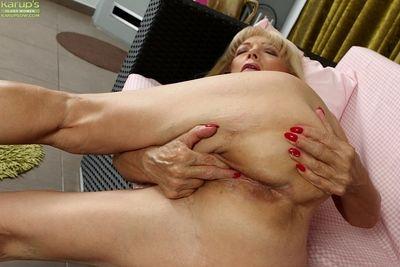 Ugly blonde Janet Lesley finger fucking shaved granny pussy