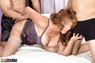 Mature lady with round boobs Sheri Fox fucks two cocks at once