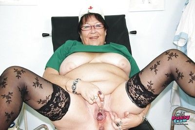 Fatty granny in lacy stockings stuffing her shaved twat with a gyno tool