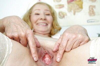 Naughty granny in white stockings showing her shaved old pussy