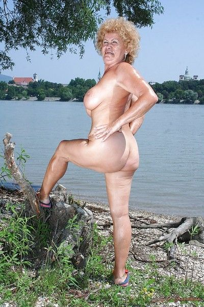 Fatty granny with big boobs stripping off her clothes outdoor