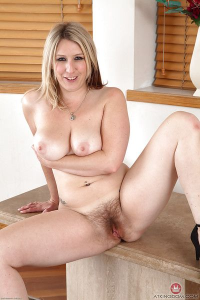 Experienced woman Mel Harper exhibiting hairy twat on counter top