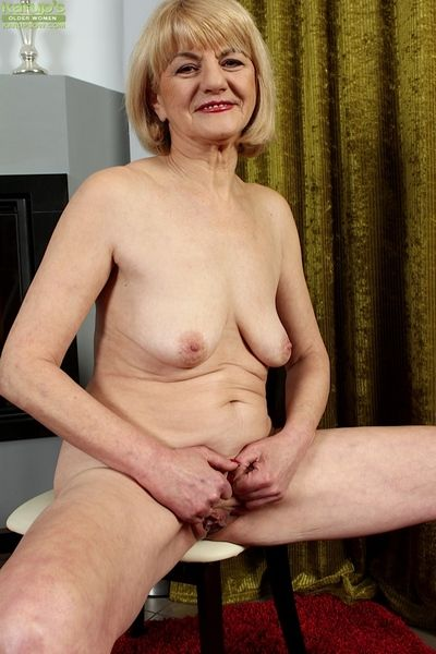 Aged blonde lady sheds dress to expose small saggy granny boobs