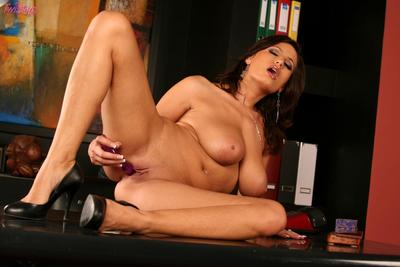 Undressed brunette babe Sensual Jane plays with her heavy hooters and shaved beaver