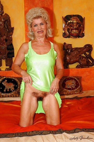 Granny with big tits and hairy pussy gets naked and feels pussy