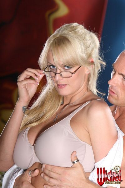 Cute four-eyed blonde Stormy Daniels has her mouth and pussy packed by tattooed guy