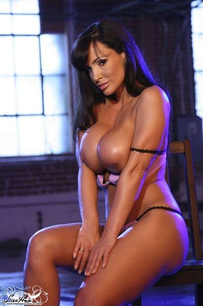 Stripping her gorgeous lingerie busty brunette bimbo Lisa Ann rubs her pussy