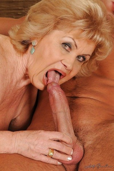 Big busted granny gives a blowjob and gets her bushy cunt banged