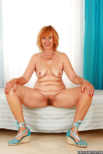 Lustful granny with hairy twat stripping and spreading her legs