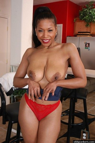 Older black woman Semmie unveiling big azz and large boobs in kitchen