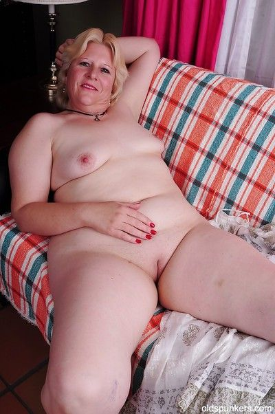 Blonde granny Toni shows off her fatty body in a white lingerie