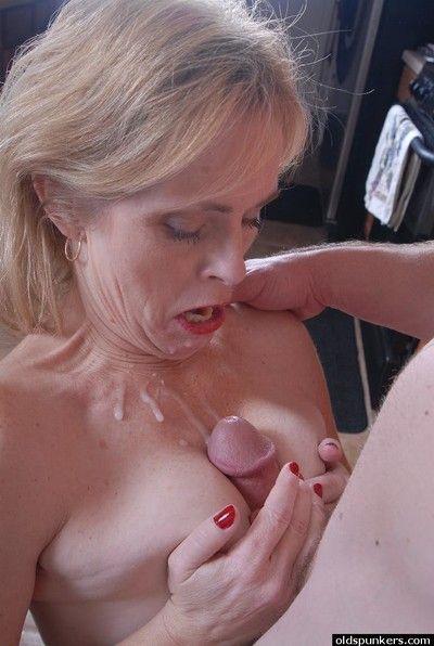 Mature MILF Pandora deepthroats younger cock while giving blowjob