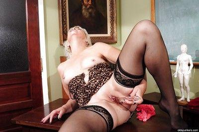 Marvelous granny Sindy masturbates in her black stockings in close up