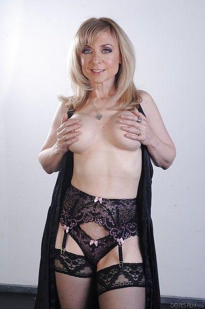 Outstanding pornstar blonde Nina Hartley shows her big boobies