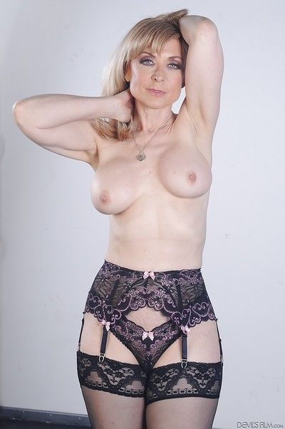 Outstanding pornstar blonde Nina Hartley shows her big boobies