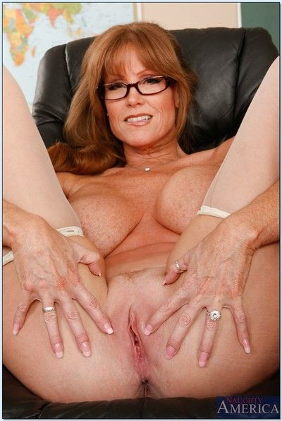 Mature teacher in glasses Darla Crane stripping and spreading her legs