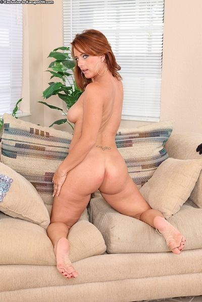 Freckled redhead Olivia Sinclair exposing nice mature boobs and bare butt