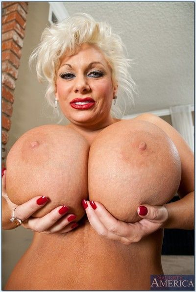 Mature bbw blonde Claudia Marie exposing her enormously big tits