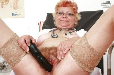 Naughty granny in stockings stuffing her twat by a toy and gyno tools