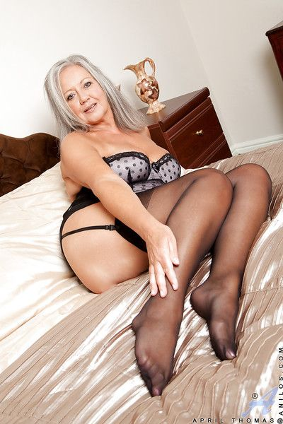 Fatty granny in stockings taking off her lingerie and toying her twat