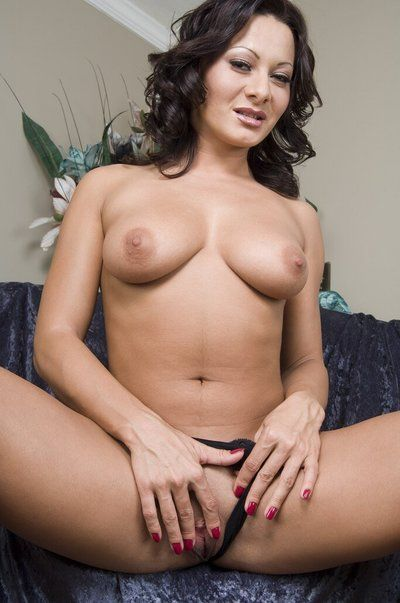 The luscious brunette babe Sandra Romain is rubbing the hand over delicious pussy