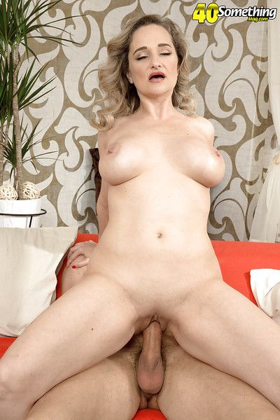 Aged lady Amelie Azzure baring huge tits before fucking younger man\