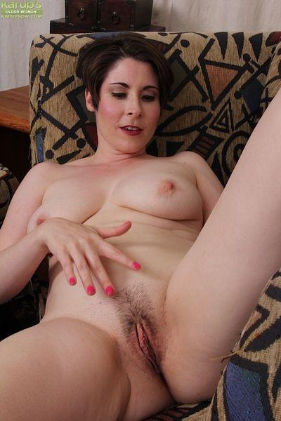 Mature housewife Sadie Jones flashing black underwear before stripping