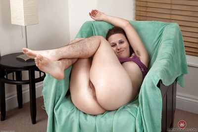Hirsute broad with small tits showing off hairy legs before baring beaver