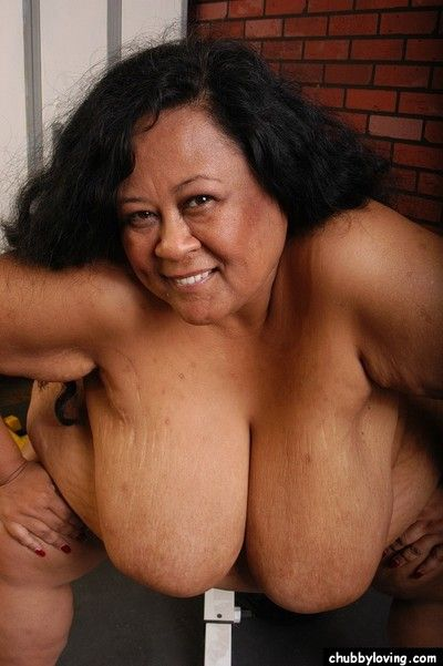 Obese older lady Debrina unleashing massive saggy boobs for nipple licking