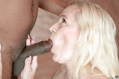 Blonde granny with saggy breasts Violett handles the black beaver-cleaver