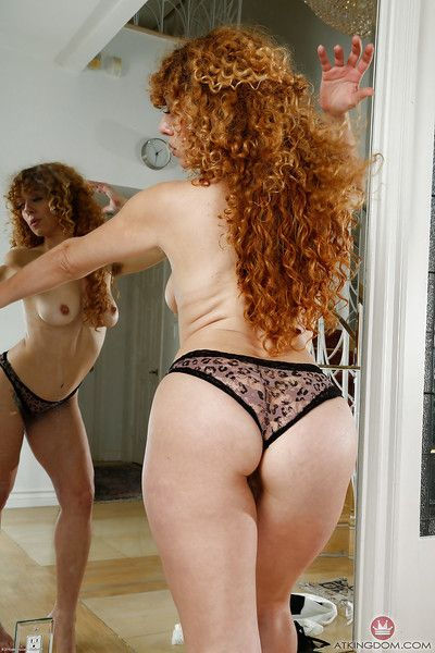 Older redhead Leona freeing hairy snatch from micro-skirt and underwear