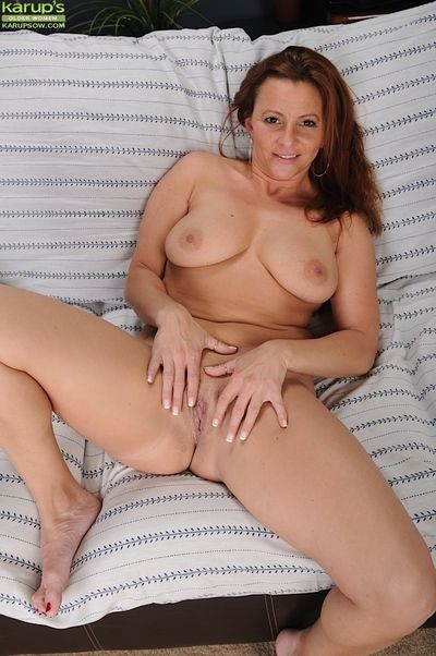 Mature beauty with big tits Gia Sophia poses in her tight panties