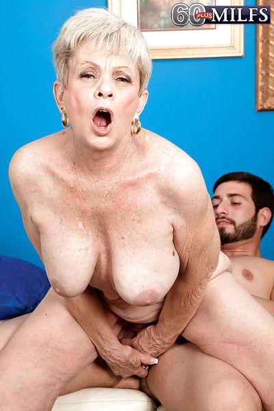 Lusty granny Lin Boyde gives a handjob and gets shagged hardcore